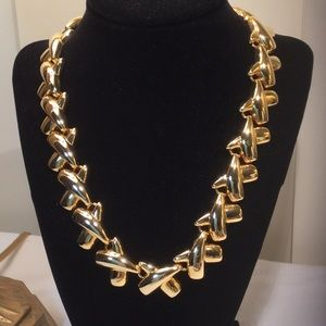 Shiny gold toned statement necklace.